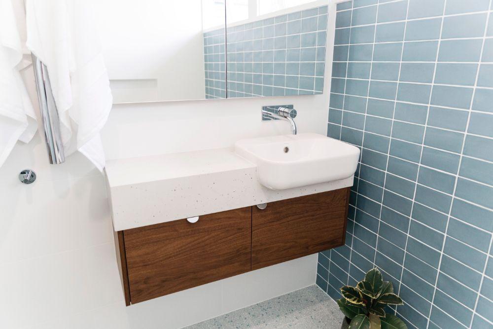 Mid-Century-modern-bathroom-with-walnut-vanity-by-Bella-Vie-Interiors
