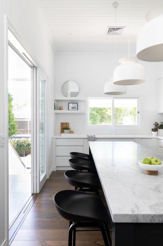 home beautiful kitchen queensland homes super white dolomite gubi pendants white kitchen queensland kitchen black cabinetry