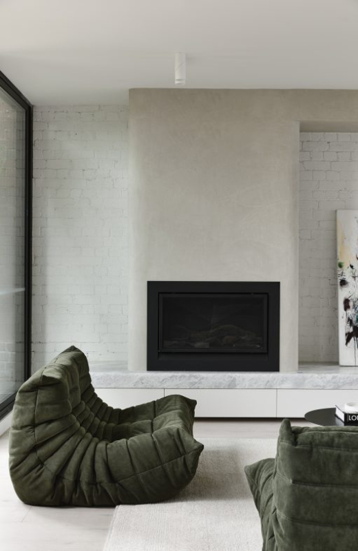 penthouse apartment brick fireplace white contemporary suede
