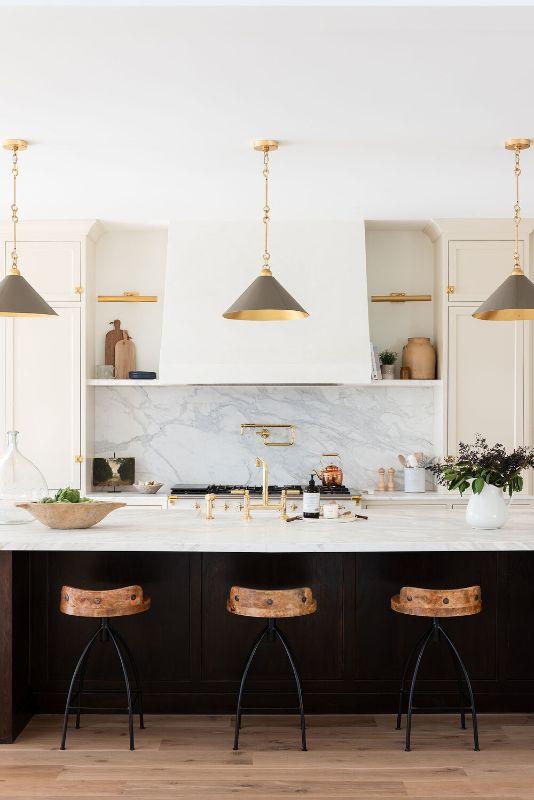 hamptons kitchen black cabinets shaker gold hardware industrial stools pendants stone benchtop