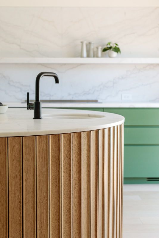 curved bench black tap kitchen stone splashback marble timber joinery